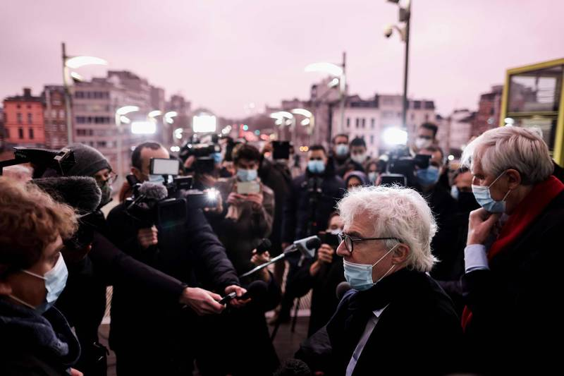 Lawyers of National Council of Resistance of Iran William Bourdon and Georges-Henri Beauthier (R) answers journalists questions as they arrive at Antwerp courthouse, on November 27, 2020, ahead of the start of the trial of four suspects including an Iranian diplomat accused of taking part in a plot to bomb an opposition rally.  In July 2018, Belgian anti-terror prosecutors announced they had foiled an attempt to bomb a June 30 meeting of the National Council of Resistance of Iran (NCRI), an exiled opposition movement, outside Paris. / AFP / Kenzo TRIBOUILLARD