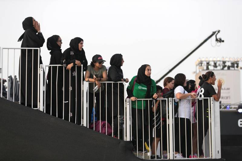 DUBAI, UNITED ARAB EMIRATES - MAY 9, 2018.   The crowd cheer their colleagues at the first day of Dubai Government Games begins, with female government employees taking part in multiple physical challenges.  Set in motion by the Crown Prince of Dubai,  Sheikh Hamdan bin Mohammed, the event sees teams of Government workers pitted against each other in a bid to be Gov Games champions.  The competition is held on Kite Beach.  (Photo by Reem Mohammed/The National)  Reporter: Nawal Al Ramahi Section: NA