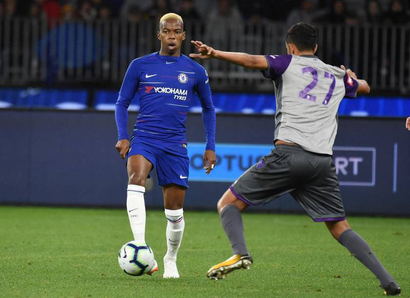 Chelsea's Charly Musonda (L) passes the ball away from Juan Prados Lopez from Perth Glory during the football friendly match at Optus Stadium in Perth on July 23, 2018.