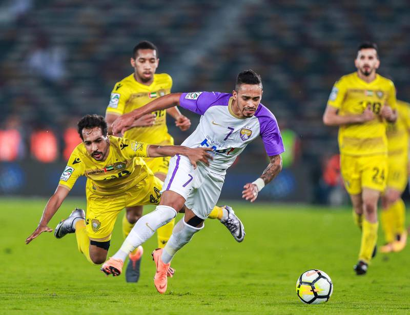 Abu Dhabi, UAE.  May 3, 2018.   President's Cup Final, Al Ain FC VS. Al .(L-R) Salem Al Azizigrabs the shirt of Anthony Caceres during the match.Wasl.  Victor Besa / The NationalSportsReporter: John McAuley