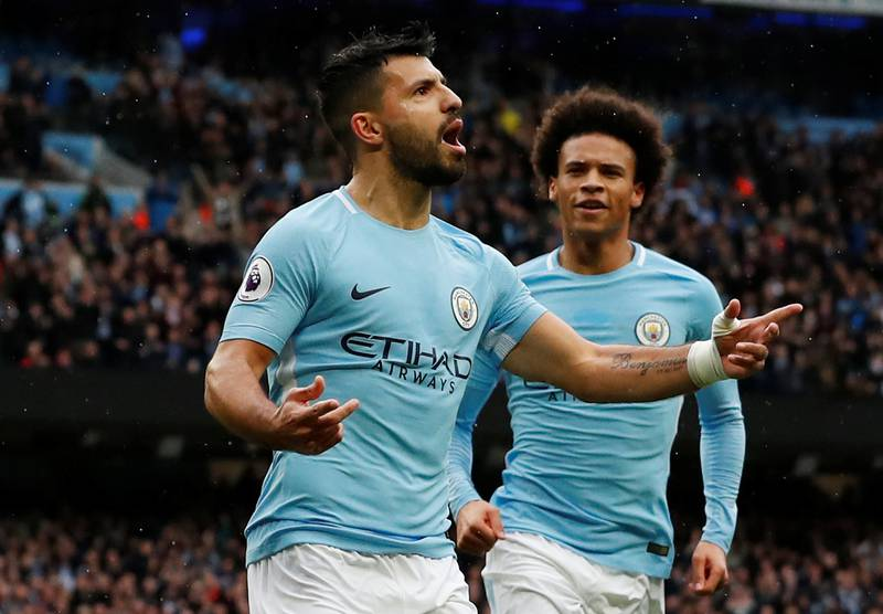 """Soccer Football - Premier League - Manchester City vs Burnley - Etihad Stadium, Manchester, Britain - October 21, 2017   Manchester City's Sergio Aguero celebrates scoring their first goal with Leroy Sane    Action Images via Reuters/Andrew Boyers    EDITORIAL USE ONLY. No use with unauthorized audio, video, data, fixture lists, club/league logos or """"live"""" services. Online in-match use limited to 75 images, no video emulation. No use in betting, games or single club/league/player publications. Please contact your account representative for further details."""