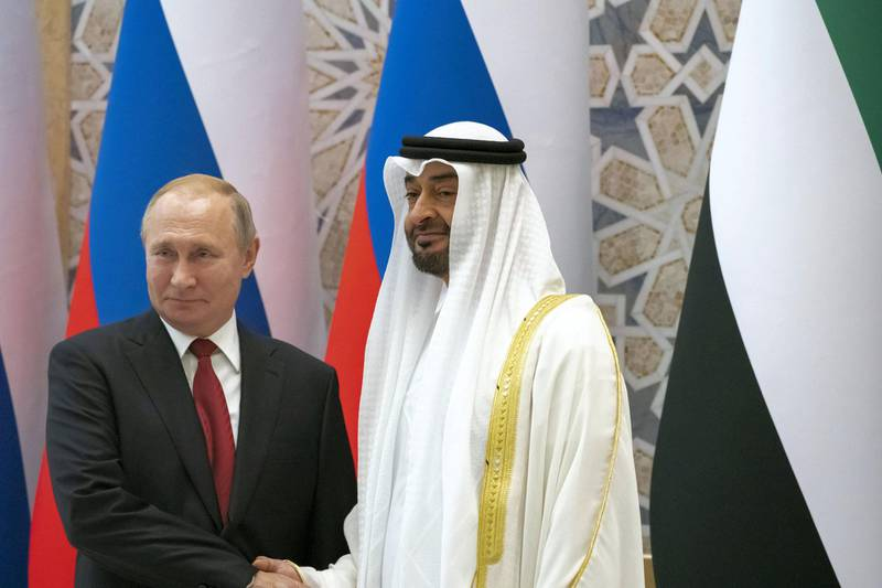 ABU DHABI, UNITED ARAB EMIRATES - October 15, 2019: HH Sheikh Mohamed bin Zayed Al Nahyan, Crown Prince of Abu Dhabi and Deputy Supreme Commander of the UAE Armed Forces (R) and HE Vladimir Putin Vladimirovich, President of Russia (L), stand for a photograph during a state visit reception at Qasr Al Watan.  ( Rashed Al Mansoori / Ministry of Presidential Affairs ) ---