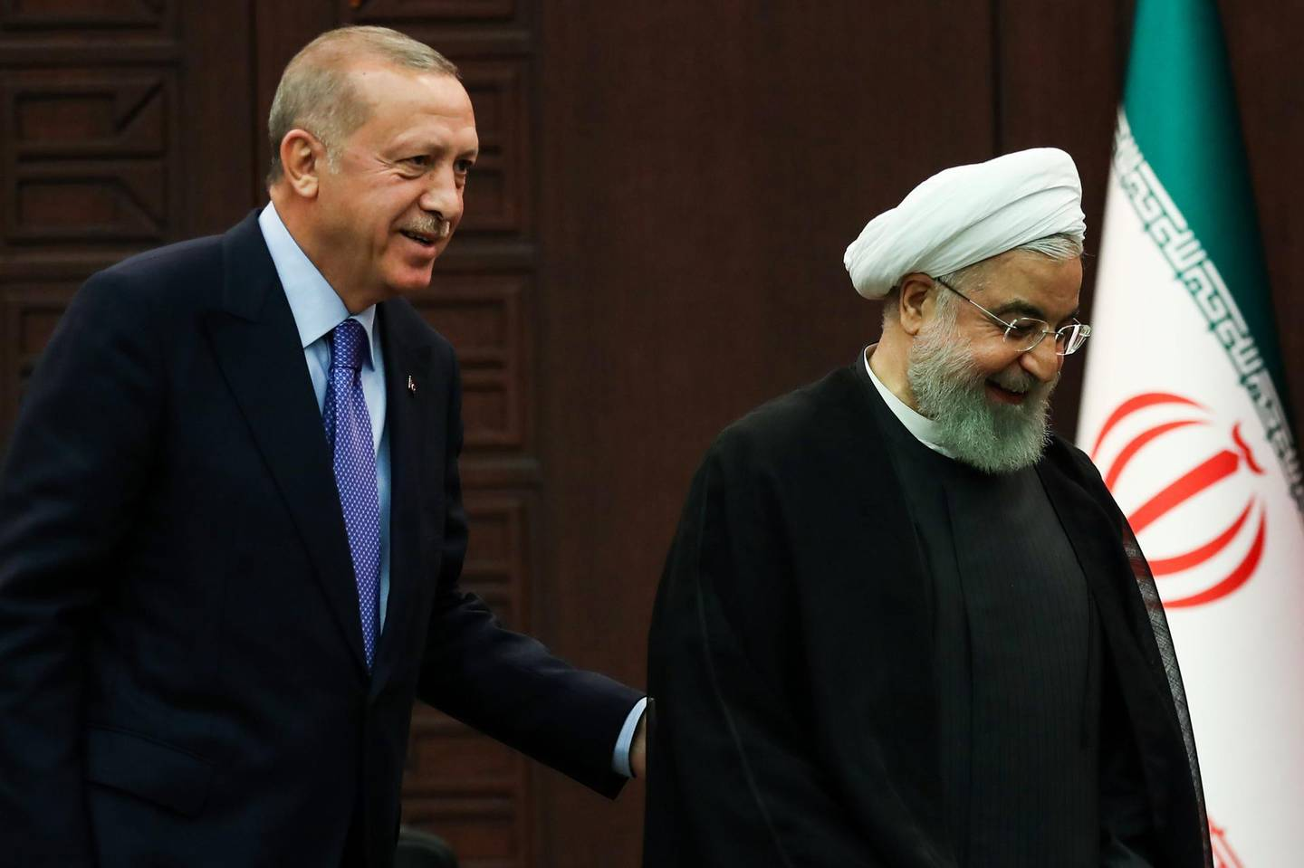 Turkish President Recep Tayyip Erdogan (L) and Iranian President Hassan Rouhani (R) leave after a press conference with Russian counterpart following a trilateral meeting on Syria, in Ankara on September 16, 2019.  / AFP / Adem ALTAN