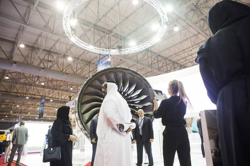 Attendees inspect an aircraft engine on the Rolls-Royce Holdings Plc exhibition stand during the 15th Dubai Air Show at Dubai World Central (DWC) in Dubai, United Arab Emirates, on Monday, Nov. 13, 2017. The biennial Dubai expo is an important venue for both manufacturers to secure deals for their biggest and most expensive jetliners. Photographer: Natalie Naccache/Bloomberg