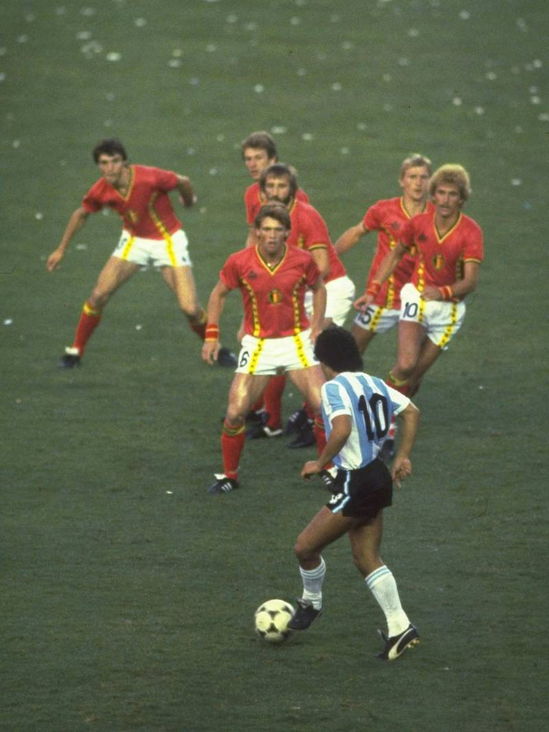 1982:  Diego Maradona of Argentina #10 is confronted by a posse of Belgium defenders during the match in the 1982 Wold Cup in Spain. \ Mandatory Credit: Steve Powell /Allsport