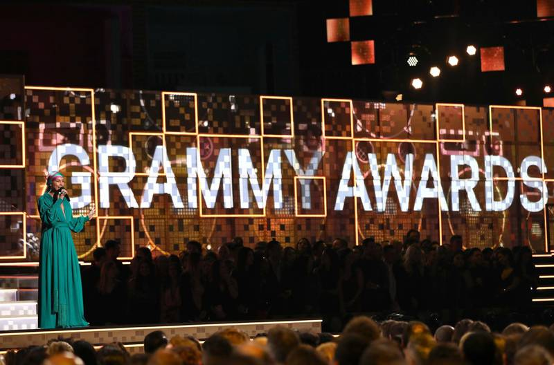 FILE - Host Alicia Keys speaks at the 61st annual Grammy Awards on Feb. 10, 2019, in Los Angeles. The Recording Academy told The Associated Press on Tuesday, Jan. 5, 2021, that the annual show would shift from its original Jan. 31 broadcast to March 14. The Grammys will be held in Los Angeles at the Staples Center. (Photo by Matt Sayles/Invision/AP, File)