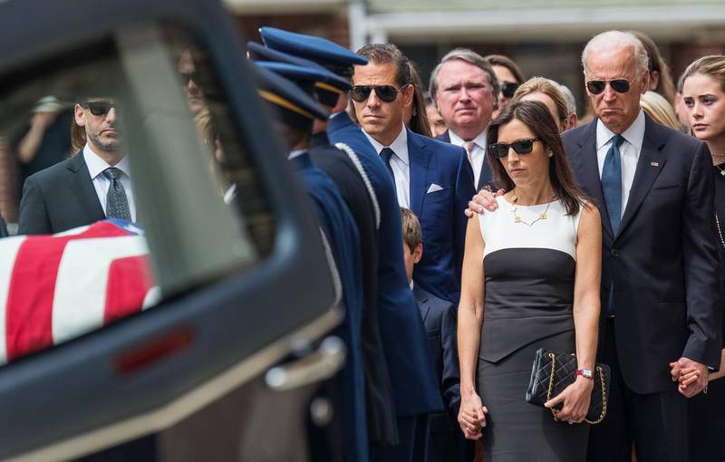 U.S. Vice President Joe Biden (R) stands with his son's brother Hunter (C) and widow Hallie (2nd R) as his son's casket is taken from a hearse before a funeral mass for former Delaware Attorney General Beau Biden, son of Vice President Biden, at St. Anthony of Padua Church in Wilmington, Delaware June 6, 2015.  REUTERS/Bryan Woolston