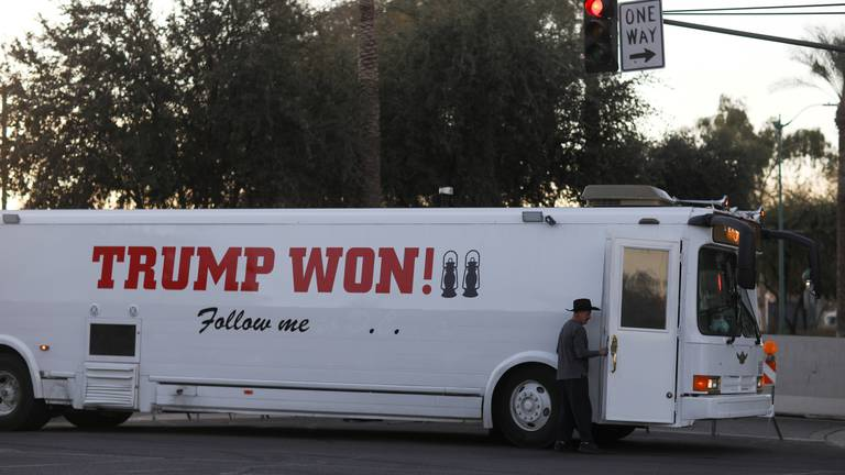 An image that illustrates this article Trump supporters probe Arizona election