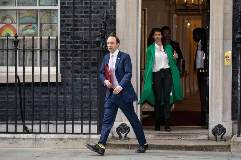 FILE PHOTO: UK Health Secretary Matt Hancock leaves 10 Downing Street with aide Gina Coladangelo - LONDON, ENGLAND  - MAY 01: Health Secretary Matt Hancock leaves 10 Downing Street with aide Gina Coladangelo after the daily press briefing on May 01, 2020 in London, England. Mr Hancock announced that the government's pledge to conduct 100,000 Covid-19 tests per day had been successful. British Prime Minister Boris Johnson, who returned to Downing Street this week after recovering from Covid-19, said the country needed to continue its lockdown measures to avoid a second spike in infections. (Photo by Dan Kitwood/Getty Images)