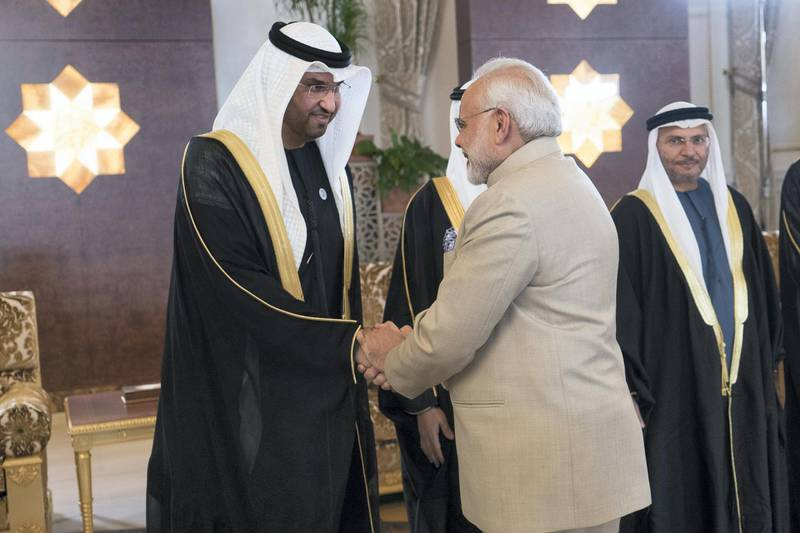 ABU DHABI, UNITED ARAB EMIRATES - February 10, 2018: HE Dr Sultan Ahmed Al Jaber, UAE Minister of State, Chairman of Masdar and CEO of ADNOC Group (L), receives HE Narendra Modi Prime Minister of India (C), at the Presidential Airport. Seen with HE Dr Anwar bin Mohamed Gargash, UAE Minister of State for Foreign Affairs (back R).   ( Rashed Al Mansoori / Crown Prince Court - Abu Dhabi  ) ---