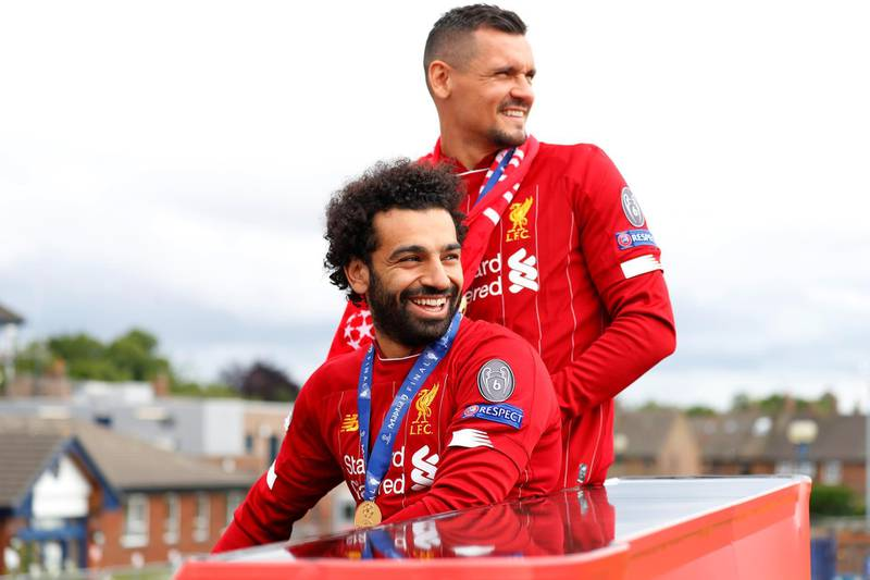 Soccer Football - Champions League - Liverpool victory parade - Liverpool, Britain - June 2, 2019  Liverpool's Mohamed Salah and Dejan Lovren during the victory parade  REUTERS/Phil Noble