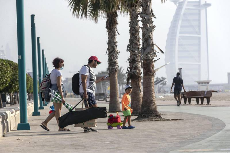 DUBAI, UNITED ARAB EMIRATES. 06 JUNE 2020. Busy Dubai beaches after the beach restrictions were lifted in Dubai. Residents and visitors visit the beach near Kite Beach in Dubai even though the timperatures are in the high 30's with high humidity. With social distancing in place the wearing of masks compulsary. (Photo: Antonie Robertson/The National) Journalist: None. Section: National.