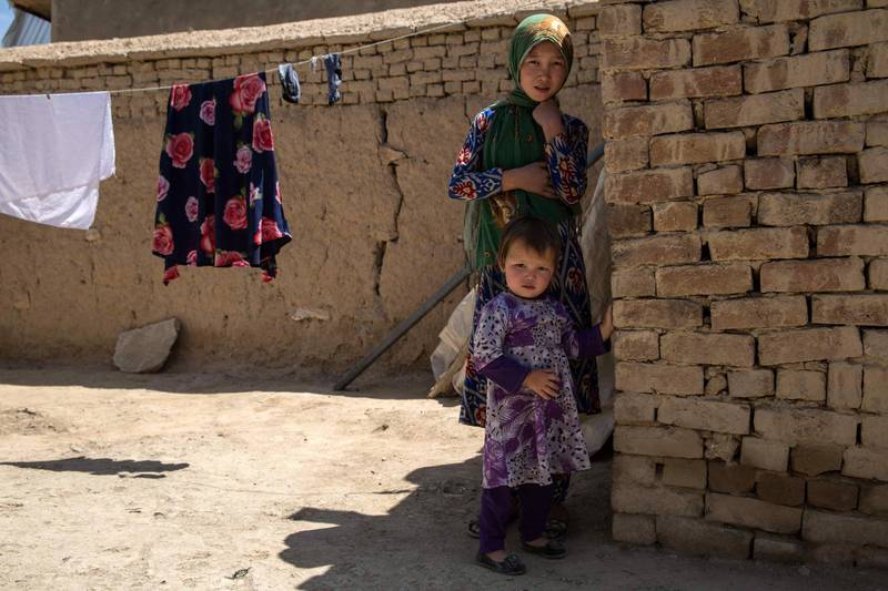 Fatima, 9 and her two-year-old sister Fereshta in their home in western Kabul. Their mother Rokaia was brutally killed in the attack on the Dasht-e-Barchi maternity ward.
