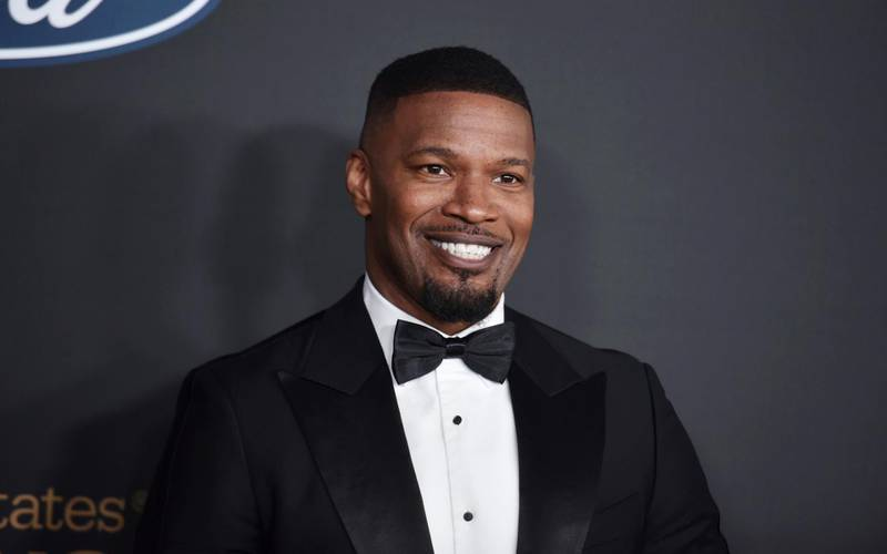 """FILE - In this Feb. 22, 2020, file photo, Jamie Foxx arrives at the 51st NAACP Image Awards at the Pasadena Civic Auditorium in Pasadena, Calif. The Pixar film """"Soul"""" will skip theaters and instead premiere on Disney+ on Christmas, the Walt Disney Co. announced Thursday, Oct. 8, 2020, sending one of the fall's last big movies straight to streaming. The film, about a middle school teacher played by Foxx, with dreams of becoming a jazz musician, was originally to premiere at the Cannes Film Festival. (Photo by Richard Shotwell/Invision/AP, File)"""