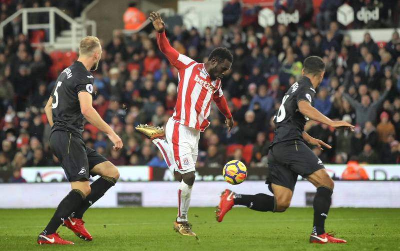 STOKE ON TRENT, ENGLAND - DECEMBER 02:  Mame Biram Diouf of Stoke City scores his sides second goal  during the Premier League match between Stoke City and Swansea City at Bet365 Stadium on December 2, 2017 in Stoke on Trent, England.  (Photo by Clive Brunskill/Getty Images)