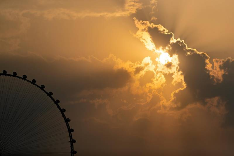 Dubai, United Arab Emirates - Reporter: N/A. News. Weather. The sun sets behind the Ain Dubai big wheel after the rain came down. Sunday, November 8th, 2020. Dubai. Chris Whiteoak / The National