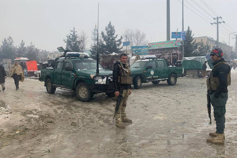 Afghan police arrive at the site of an explosion near the military academy in Kabul, Afghanistan, Tuesday, Feb. 11, 2020. An explosion occurred early Tuesday near the military academy in a southern neighborhood of the Afghan capital, a government spokesman said. (AP Photo/Rahmat Gul)