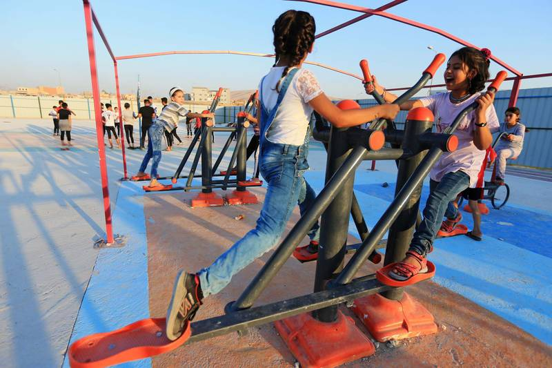Displaced Iraqi children from the minority Yazidi sect, who fled the Iraqi town of Sinjar, play at Sharya camp on the outskirts of Duhok province, July 30, 2019. Picture taken July 30, 2019.  REUTERS/Ari Jalal