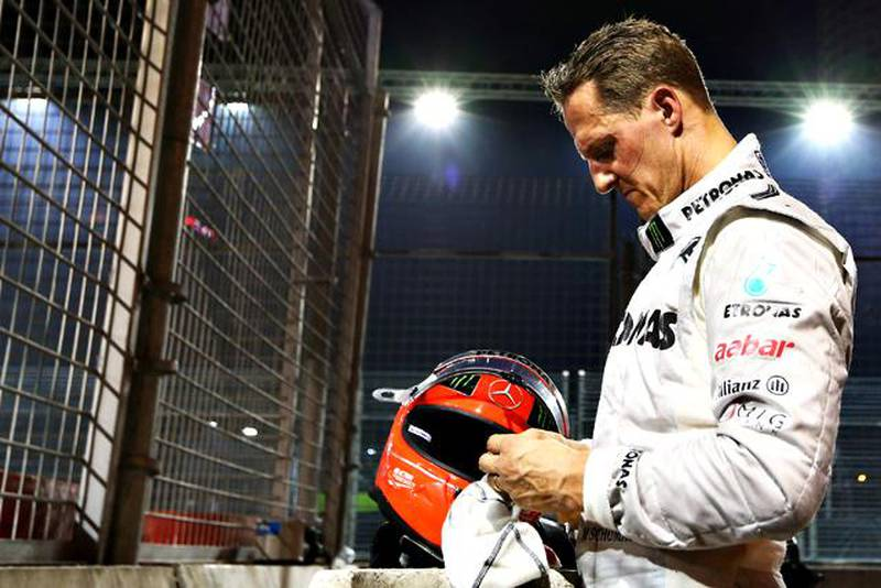 FILE - OCTOBER 04, 2012:  Michael Schumacher has announced his retirement from Formula One after a career spanning two spells during which he won a total of seven world titles, including five straight titles during his time with Ferrari. SINGAPORE - SEPTEMBER 23:  Michael Schumacher of Germany and Mercedes GP retires early after crashing into the back of Jean-Eric Vergne of France and Scuderia Toro Rosso during the Singapore Formula One Grand Prix at the Marina Bay Street Circuit on September 23, 2012 in Singapore, Singapore.  (Photo by Robert Cianflone/Getty Images)