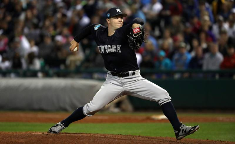 Mar 9, 2018; Lake Buena Vista, FL, USA; New York Yankees starting pitcher Sonny Gray (55) throws a pitch during the third inning against the Atlanta Braves at Champion Stadium. Mandatory Credit: Kim Klement-USA TODAY Sports