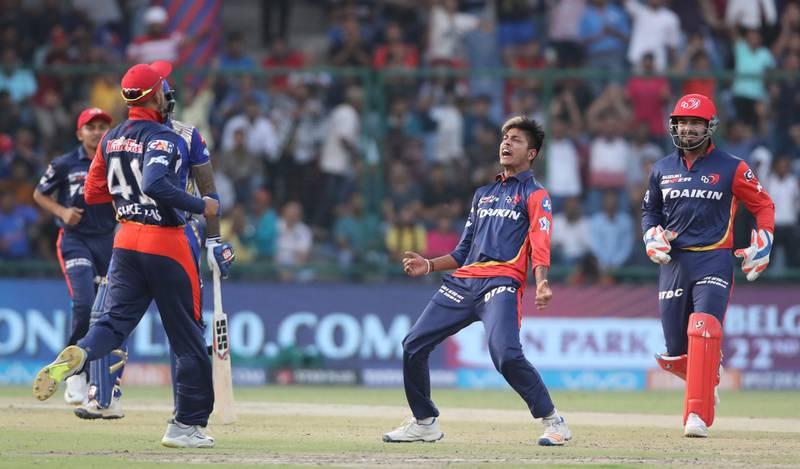 Delhi Daredevils Sandeep Lamichhane, center, celebrates the wicket of Mumbai Indians Surya kumar Yadav during the VIVO IPL Twenty20 cricket match in New Delhi, India, Sunday, May 20, 2018. (AP Photo/Manish Swarup)