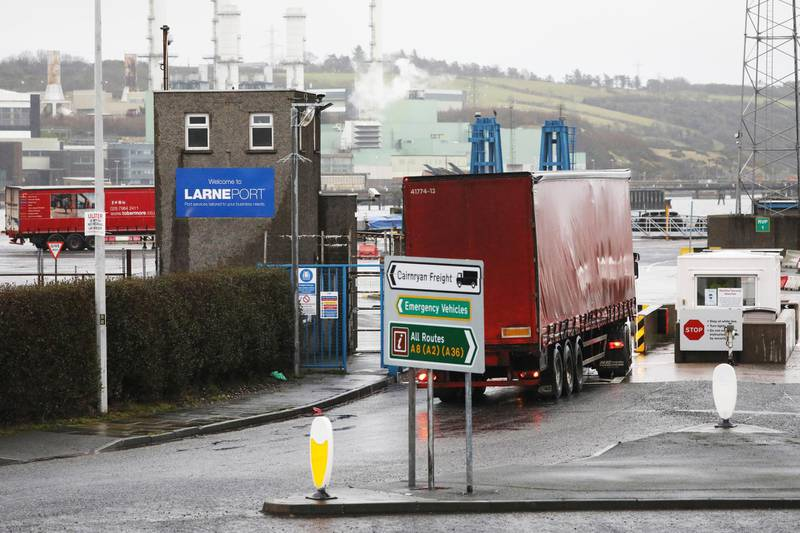 Vehicles at the port of Larne, Northern Ireland, Tuesday, Feb. 2, 2021.  Authorities in Northern Ireland have suspended post-Brexit border checks on animal products and withdrawn workers after threats against border staff. (AP Photo/Peter Morrison)