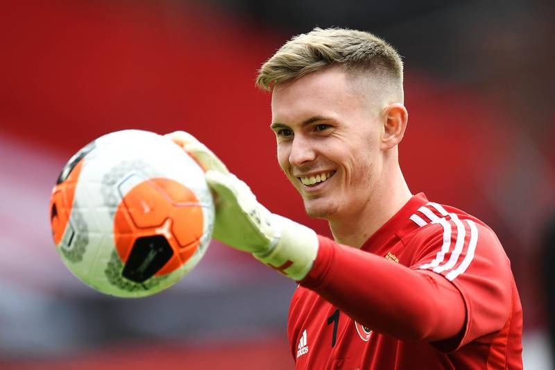 (FILES) In this file photo taken on July 20, 2020 Sheffield United's English goalkeeper Dean Henderson warms up prior to the  English Premier League football match between Sheffield United and Everton at Bramall Lane stadium in Sheffield, northern England. Goalkeeper Dean Henderson has signed a new long-term contract with Manchester United, the Premier League club announced on Wednesday, August 26. - RESTRICTED TO EDITORIAL USE. No use with unauthorized audio, video, data, fixture lists, club/league logos or 'live' services. Online in-match use limited to 120 images. An additional 40 images may be used in extra time. No video emulation. Social media in-match use limited to 120 images. An additional 40 images may be used in extra time. No use in betting publications, games or single club/league/player publications.  / AFP / POOL / PETER POWELL / RESTRICTED TO EDITORIAL USE. No use with unauthorized audio, video, data, fixture lists, club/league logos or 'live' services. Online in-match use limited to 120 images. An additional 40 images may be used in extra time. No video emulation. Social media in-match use limited to 120 images. An additional 40 images may be used in extra time. No use in betting publications, games or single club/league/player publications.