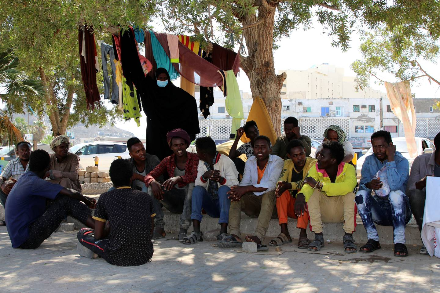 Ethiopian migrants gather to protest their treatment in the war-torn country during a sit-in outside a compound of United Nations organizations in the southern port city of Aden, Yemen March 15, 2021.  Picture taken March 15, 2021. REUTERS/Fawaz Salman