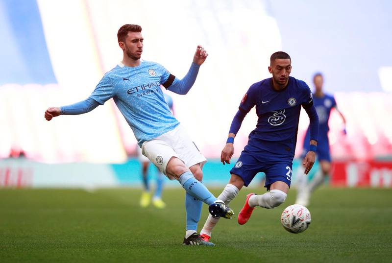 FILE PHOTO: Soccer Football -  FA Cup Semi Final - Chelsea v Manchester City  - Wembley Stadium, London, Britain - April 17, 2021 Manchester City's Aymeric Laporte in action with Chelsea's Hakim Ziyech Pool via REUTERS/Ian Walton/File Photo
