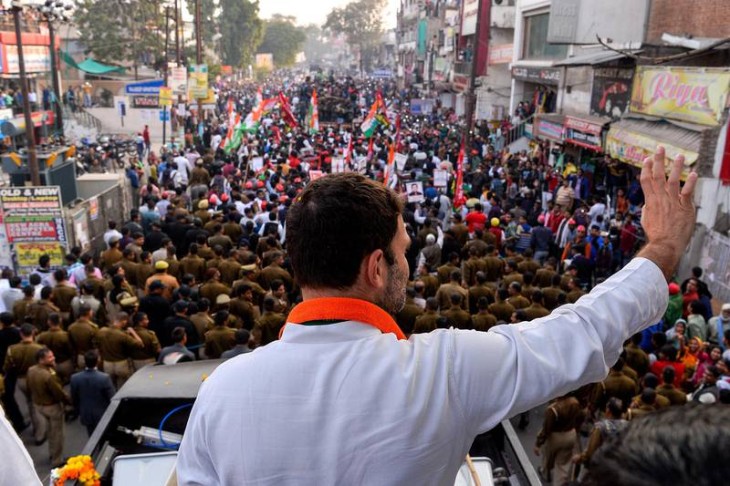 Congress party Vice President Rahul Gandhi waves to the crowd during a joint election rally with the Uttar Pradesh state chief minister in Agra on February 3, 2017. - Elections in northern Uttar Pradesh begin on February 11, voting is divided into seven phases. Results from all the elections will be declared on 11 March. (Photo by CHANDAN KHANNA / AFP)