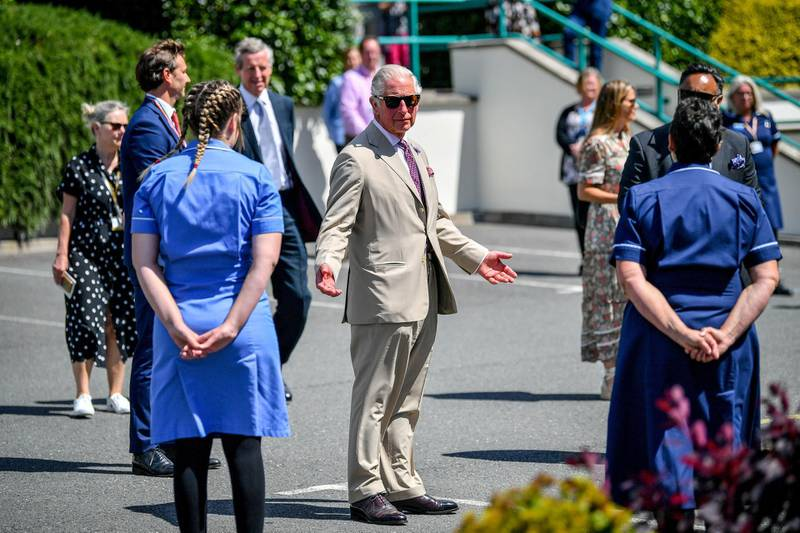 ST. AUSTELL, ENGLAND - JULY 21: Prince Charles, The Duke of Cornwall chats with care workers as he visits St Austell Healthcare, the Wheal Northey Centre, to recognise and thank staff for their efforts during Covid-19 pandemic on July 21, 2020 in St Austell, England. (Photo by Ben Birchall -WPA Pool/Getty Images)