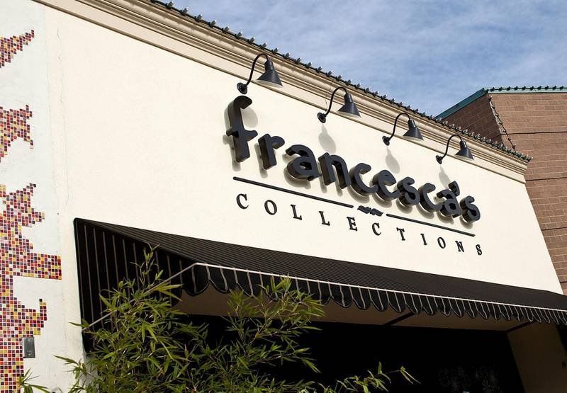 Signage for Francesca's Collections, a subsidiary of Francesca's Holdings Corp., is displayed outside of a store in Shrewsbury, New Jersey, U.S., on Friday, Dec. 2, 2011. Francesca's Holdings Corp. is scheduled to announce earnings on Dec. 6. Photographer: Emile Wamsteker/Bloomberg