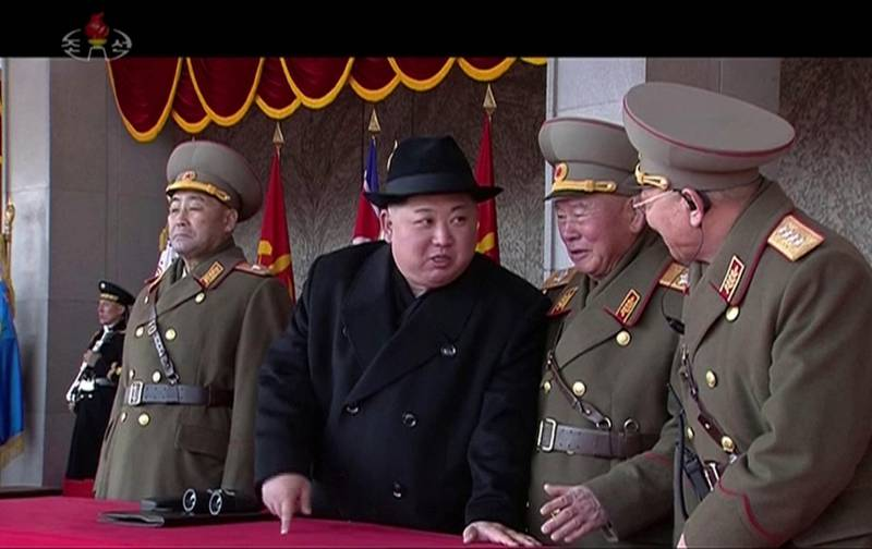 In this image made from video by North Korea's KRT, North Korean leader Kim Jong Un, center, speaks with military officials during a military parade in Pyongyang, North Korea Thursday, Feb. 8, 2018. North Korea held the military parade and rally on Kim Il Sung Square on Thursday, just one day before South Korea hosts the opening ceremony of the Pyeongchang Winter Olympics. (KRT via AP Video)