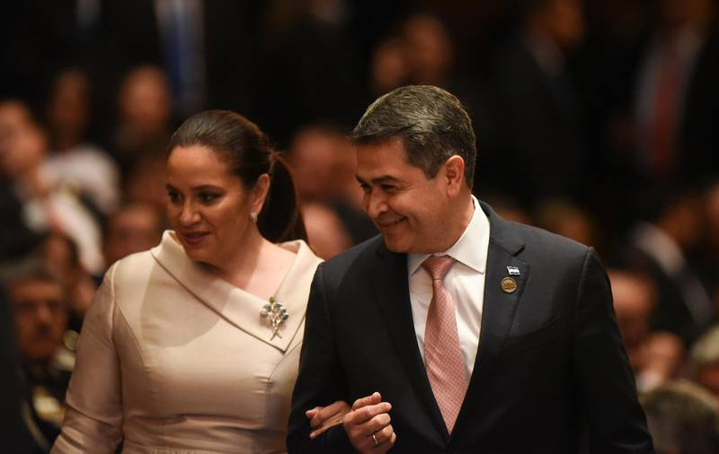 Honduran's President Juan Orlando Hernandez and his wife Ana Garcia arrives a ceremony inauguration of Guatemalan new President Alejandro Giammattei at the National Theater, in Guatemala City, on January 14, 2020. - The doctor right-wing Alejandro Giamattei assumes as president of Guatemala in replacement of the unpopular Jimmy Morales, with the promise of attacking corruption and contain the high levels of poverty. (Photo by Johan ORDONEZ / AFP)