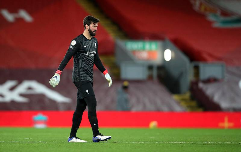 LIVERPOOL, ENGLAND - JANUARY 21: Alisson Becker of Liverpool looks dejected following defeat in the Premier League match between Liverpool and Burnley at Anfield on January 21, 2021 in Liverpool, England. Sporting stadiums around the UK remain under strict restrictions due to the Coronavirus Pandemic as Government social distancing laws prohibit fans inside venues resulting in games being played behind closed doors. (Photo by Clive Brunskill/Getty Images)