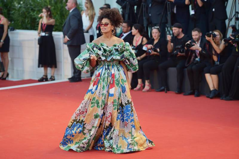 """VENICE, ITALY - AUGUST 31: Zazie Beetz walks the red carpet ahead of the """"Joker"""" screening during the 76th Venice Film Festival at Sala Grande on August 31, 2019 in Venice, Italy. (Photo by Theo Wargo/Getty Images)"""
