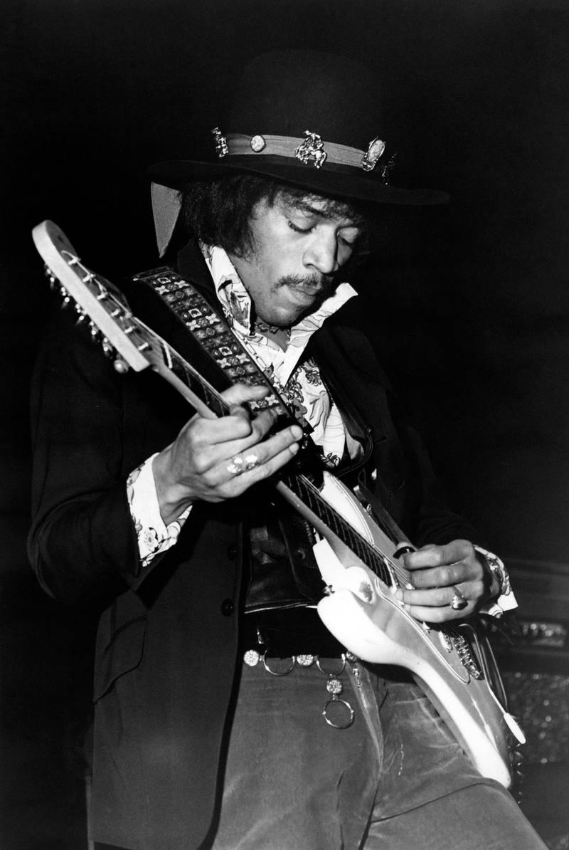 UNITED KINGDOM - JANUARY 01:  Photo of Jimi HENDRIX and JIMI HENDRIX EXPERIENCE; Jimi Hendrix performing on stage, playing white Fender Stratocaster guitar  (Photo by Val Wilmer/Redferns)