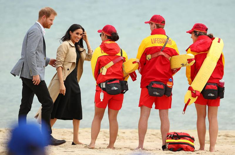 MELBOURNE, AUSTRALIA - OCTOBER 18:  Prince Harry, Duke of Sussex and Meghan, Duchess of Sussex meet with lifeguards at South Melbourne Beach on October 18, 2018 in Melbourne, Australia. BeachPatrol is a network of volunteers who are passionate about keeping Melbourne's beaches and foreshores clear of litter to reduce the negative impact of litter on the marine environment and food chain, and provide a safe environment for the public to enjoy their local beach.The Duke and Duchess of Sussex are on their official 16-day Autumn tour visiting cities in Australia, Fiji, Tonga and New Zealand.  (Photo by Scott Barbour/Getty Images)