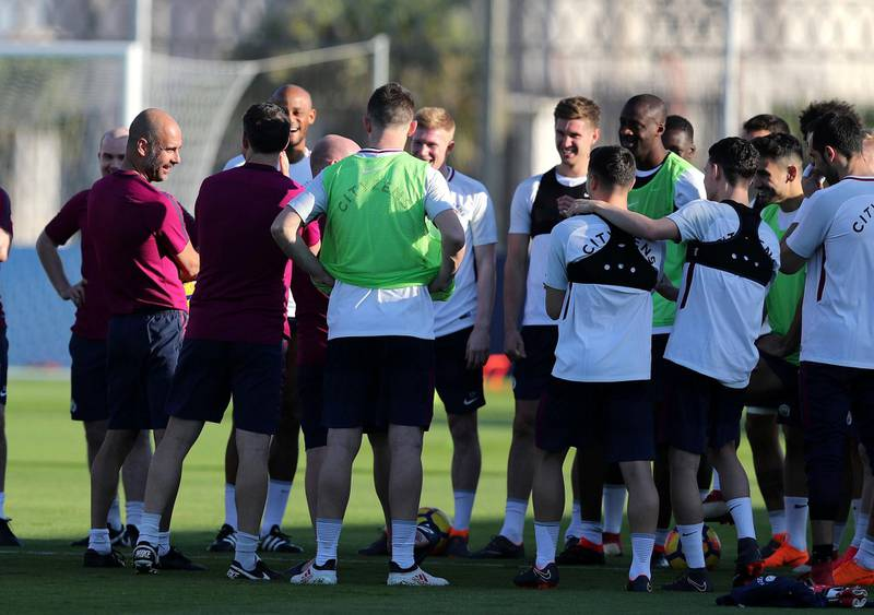 Abu Dhabi, United Arab Emirates - March 15th, 2018: Manager of Manchester City Pep Guardiola speaks to his team during a training session in Abu Dhabi. Thursday, March 15th, 2018. Emirates Palace, Abu Dhabi. Chris Whiteoak / The National