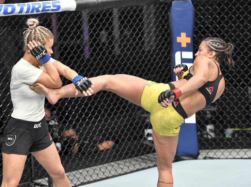 ABU DHABI, UNITED ARAB EMIRATES - JULY 12: (R-L) Amanda Ribas of Brazil kicks Paige VanZant in their flyweight fight during the UFC 251 event at Flash Forum on UFC Fight Island on July 12, 2020 on Yas Island, Abu Dhabi, United Arab Emirates. (Photo by Jeff Bottari/Zuffa LLC)