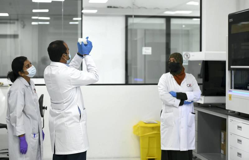 Abu Dhabi, United Arab Emirates - Staff member working at Omics Labs, Masdar City. Khushnum Bhandari for The National
