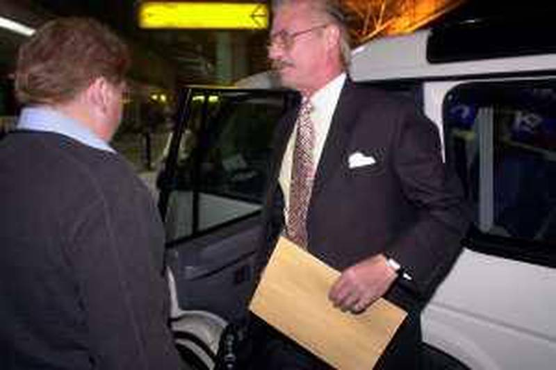 Briton Peter Bleach (R) steps out from a British Deputy High Commissioner's car at the Netagi Subhash Chandra Bose International Airport in Calcutta, 06 February 2004.  Bleach who was serving a life sentence after being convicted of gun-traficking, was released from custody after eight years in jail on 04 February and left for London. AFP PHOTO/Deshakalyan CHOWDHURY