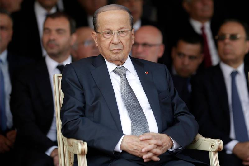 """FILE - In this Aug. 1, 2019 file photo, Lebanese President Michel Aoun attends a graduation ceremony marking the 74th Army Day, at a military barracks in Beirut's suburb of Fayadiyeh, Lebanon. Aoun said Saturday, Aug. 24,  his country will emerge from its difficult economic conditions by making decisions that boost production, and a top politician said politicians will be called for a meeting """"to discuss the challenges."""" His comments came a day after Fitch Ratings downgraded Lebanon's long-term foreign currency issuer default rating to CCC from B-. (AP Photo/Hassan Ammar, File)"""