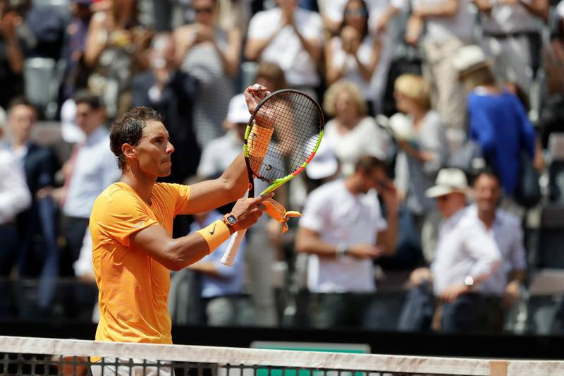 Spain's Rafael Nadal celebrates after winning a quarter final match against Italy's Fabio Fognini, at the Italian Open tennis tournament in Rome, Friday, May 18, 2018. Nadal won 4-6, 6-1, 6-2. (AP Photo/Andrew Medichini)