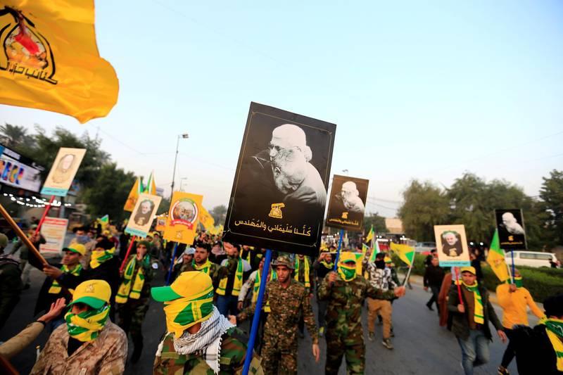 Kataib Hezbollah Iraqi militia gather ahead of the funeral of the Iraqi militia commander Abu Mahdi al-Muhandis, who was killed in an air strike at Baghdad airport, in Baghdad, Iraq, January 4, 2020. REUTERS/Thaier al-Sudani