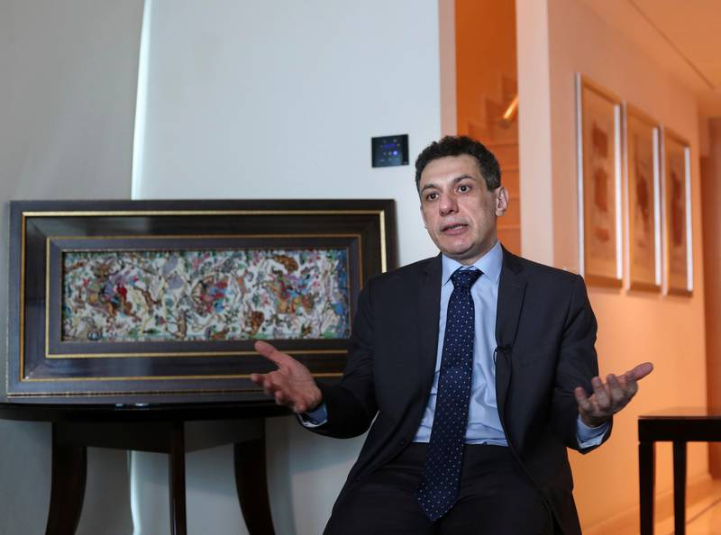 """Nizar Zakka, a Lebanese citizen and permanent U.S. resident who was released in Tehran after nearly four years in jail on charges of spying, speaks during an interview with The Associated Press at a hotel in Dbayeh, north of Beirut, Lebanon, Wednesday, June 12, 2019. Zakka, an information technology expert, who was detained in Iran in September 2015 while trying to fly out of Tehran called on President Donald Trump to """"get back your hostages"""" from Iran. He was sentenced to 10 years in prison after authorities accused him of being an American spy - allegations vigorously rejected by Zakka, his family and associates. (AP Photo/Bilal Hussein)"""