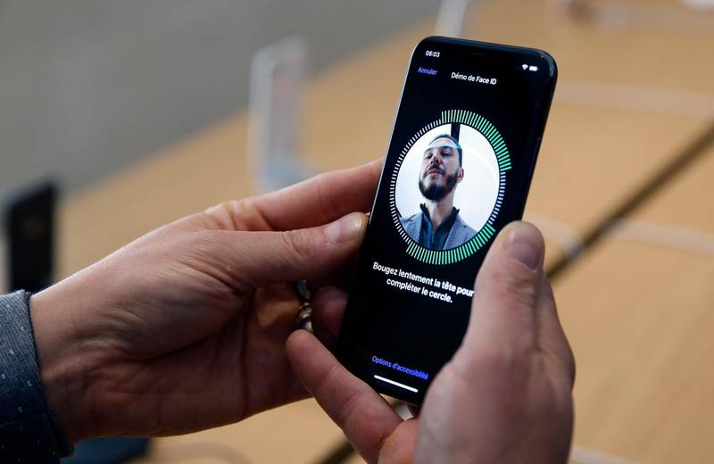 PARIS, FRANCE - NOVEMBER 03:  A customer uses the new face-recognition software on the Apple iPhone X, the new model of Apple smartphone at the Apple Store Saint-Germain on November 3, 2017 in Paris, France. Apple's latest iPhone X features face recognition technology, a large 5.8-inch edge-to-edge high resolution OLED display and better front and back cameras with optical image stabilisation.  (Photo by Chesnot/Getty Images)