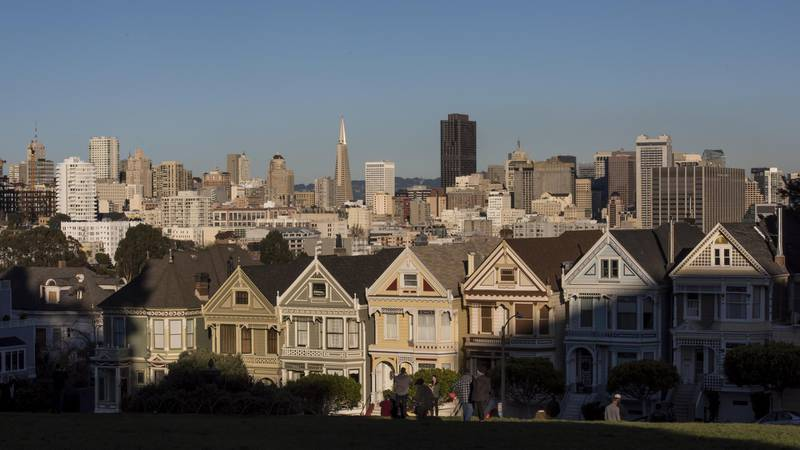 The downtown skyline stands past Victorian homes in San Francisco, California, U.S., on Tuesday, Dec. 29, 2015. Home values in 20 U.S. cities rose at a faster pace in the year ended October as lean inventories of available properties combined with steadily improving demand. Photographer: David Paul Morris/Bloomberg