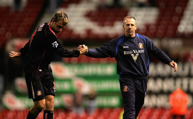 MANCHESTER, UNITED KINGDOM - APRIL 14: Caretaker manager of Sunderland Kevin Ball (R) shakes hands with Chris Brown of Sunderland after their side's goaless draw and relegation in the Barclays Premiership match between Manchester United and Sunderland at Old Trafford on April 14, 2006 in Manchester,England.  (Photo by Michael Steele/Getty Images)