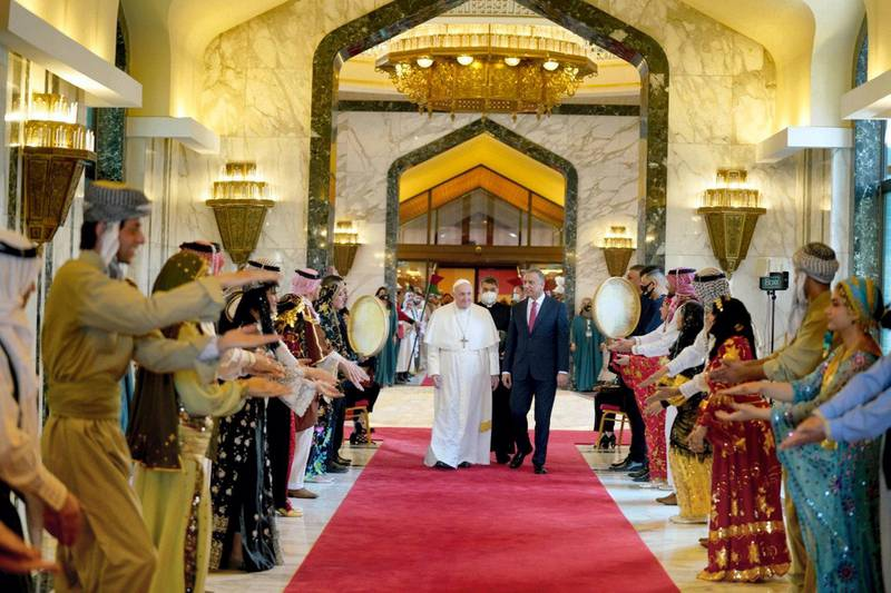 The Pope is welcomed by Iraq's prime minister Mustafa Al Kadhimi on arrival at Baghdad airport. Handout from the office of the Prime Minister of Iraq